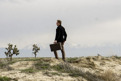 Man in wilderness with briefcase
