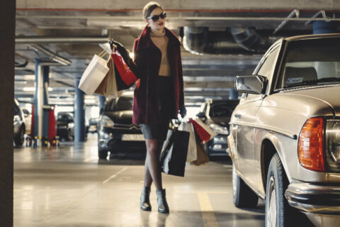 Rich woman with shopping bags