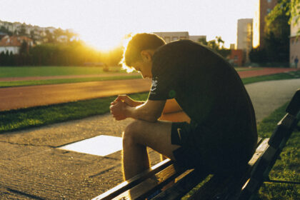 Athlete resting on a bench